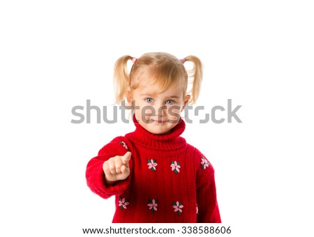Stock Photo Little girl with ponytails in a warm red sweater isolated on a white background.