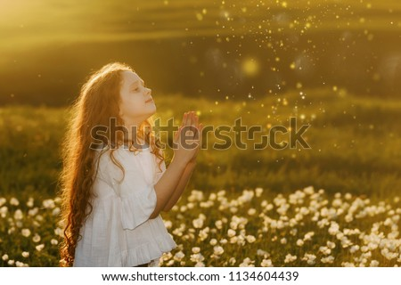Little girl with praying. Peace, hope, dreams concept. #1134604439