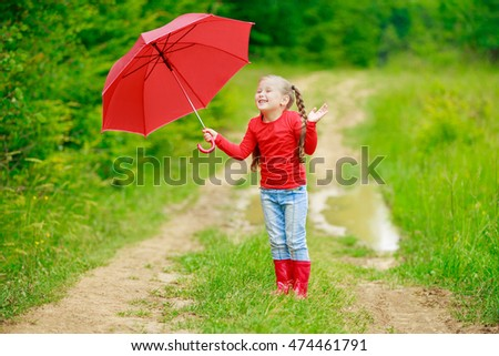 little girl with red umbrella #474461791