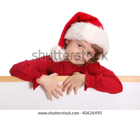 Little girl with santa hat holding white banner