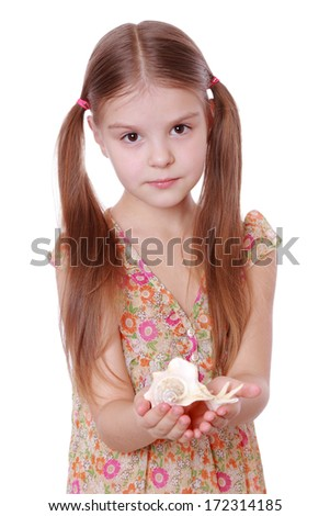 little girl with sea shell #172314185