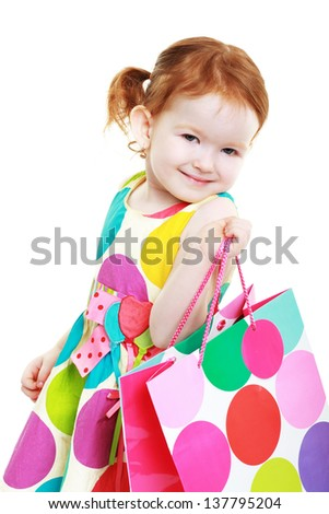 little girl with shopping bag cheerful shopaholic