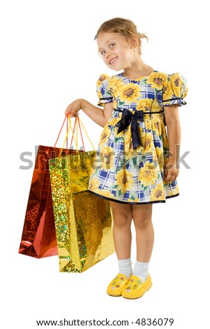Little girl with shopping bag. Isolate on white background.