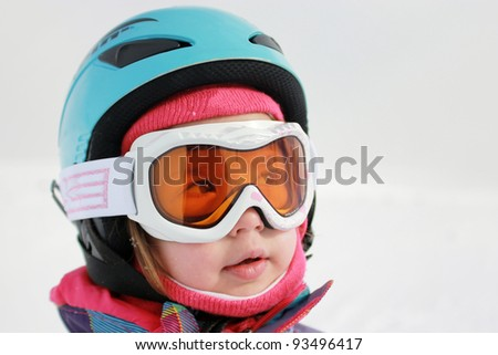 Little girl with ski helmet