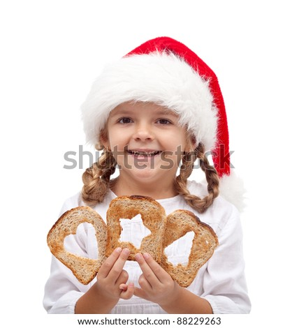 Little girl with slices of bread and santa hat - sharing and love at christmas time concept