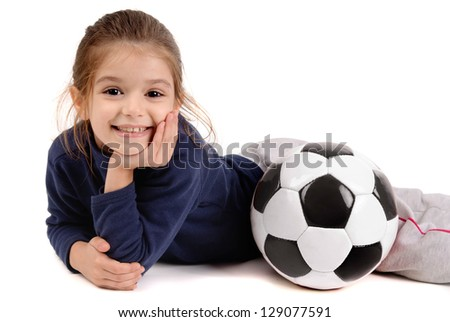 little girl with soccer ball - stock photo