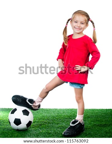 little girl with soccer ball in boots on a green lawn over white