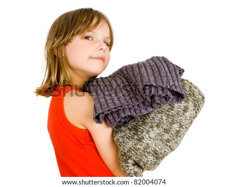little girl with stack of sweaters isolated on white