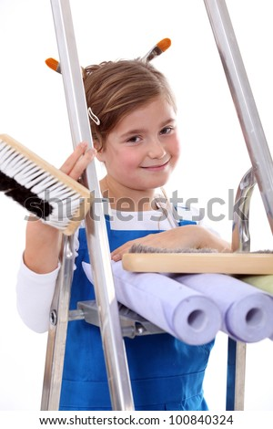 Little girl with step ladder and wallpaper