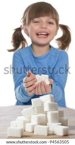little girl with sugar cubes isolated on white background