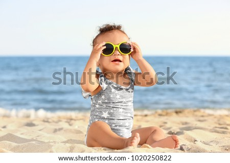 little girl with sunglasses on...