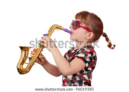 little girl with sunglasses play music on saxophone