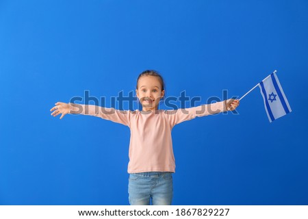 Little girl with the flag of Israel on color background Stok fotoğraf ©
