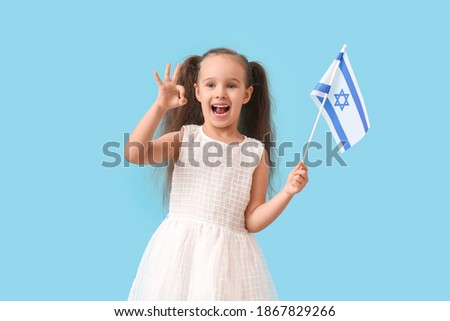 Little girl with the flag of Israel showing OK on color background Stok fotoğraf ©