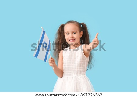 Little girl with the flag of Israel showing thumb-up on color background Stok fotoğraf ©