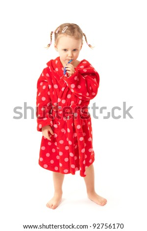 Little girl with toothbrush in red dressing-gown - stock photo