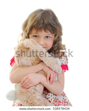 Little girl with toy hare. isolated on a white background
