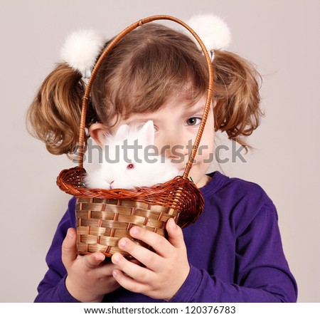 little girl with white rabbit pet