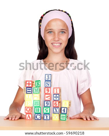 Little girl with with wooden blocks stacked isolated on white background