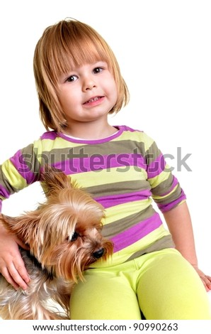 Little girl with Yorkie