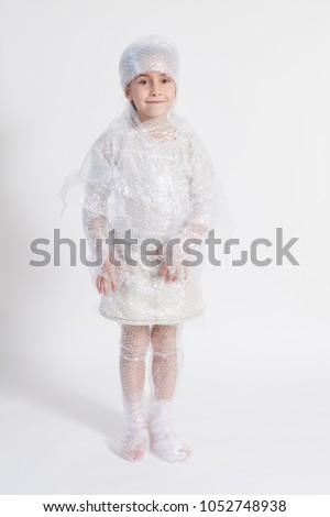 little girl wrapped in bubble wrap