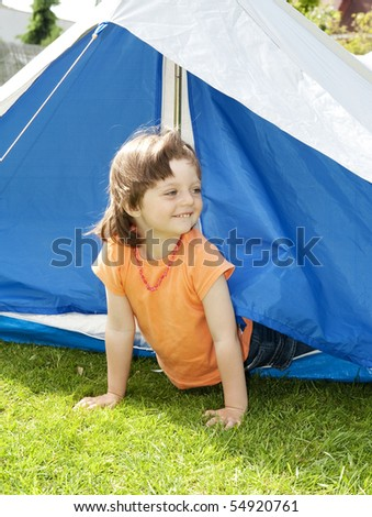 little girl 3 years old in a tent
