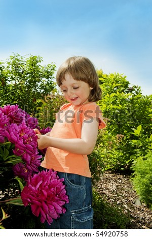 little girl 3 years old with peony flowers