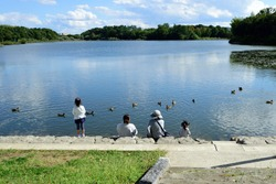 Little girls and ducks by the pond, central Japan.