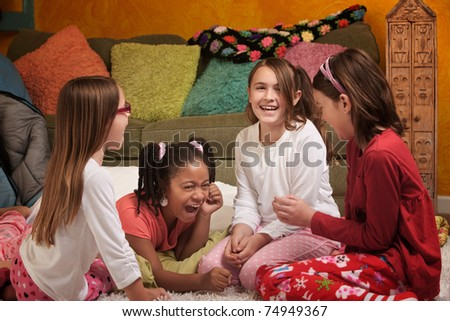 Little Girls at a sleepover laugh together
