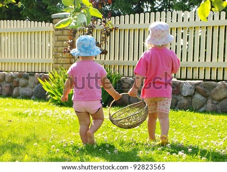 Little girls carrying basket