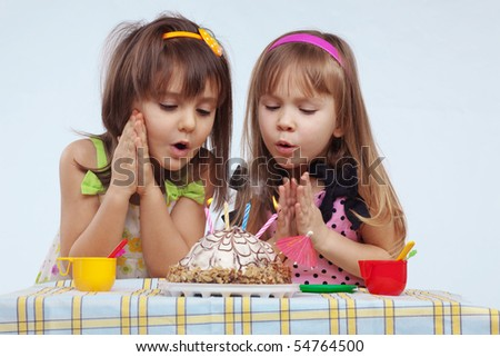 Little girls eating birthday cake