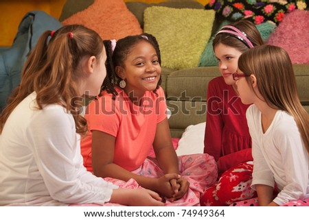 Little girls engrossed in an interesting conversation
