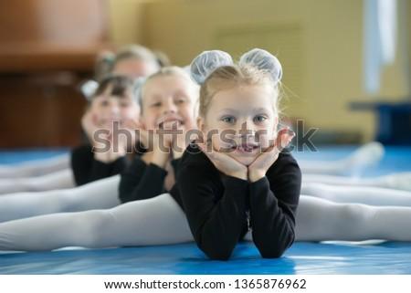 Flexible little girls doing gymnastics split Images and