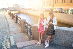Little girls on the promenade at the summer in Saint Petersburg