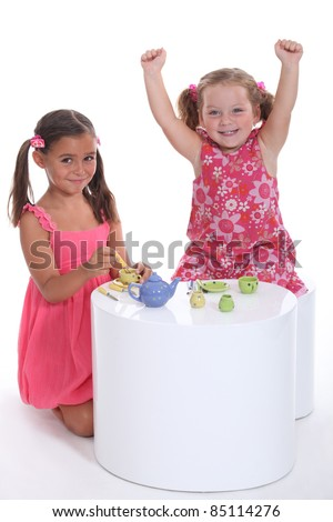 little girls playing at tea parties