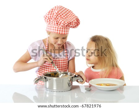 Little girls preparing a soup