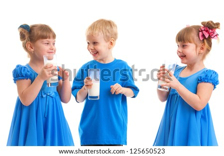 Little girls-twins and boy are drinking milk of glasses in their hands and are laughing on white background.
