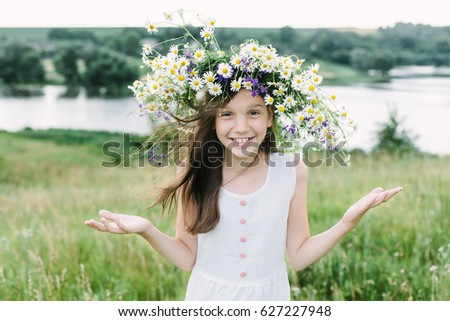 Little girls wear flower wreath plays the ape and grimacing #627227948