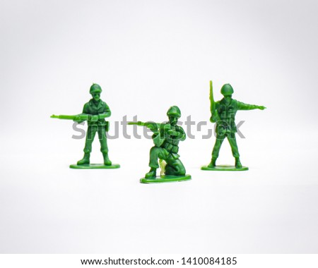 Toy green army man costume (and gun)