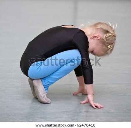 little gymnast girl doing exercises
