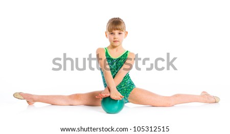 Little gymnast with ball on a white background. Sporting exercise, stretch, flexibility, aerobics