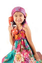 Little gypsy girl talking on phone