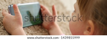 Little hacker girl of generation z using mobile phone for entertain oneself from boring routine life closeup #1439855999
