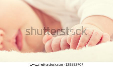 little hand of sleeping baby newborn close up