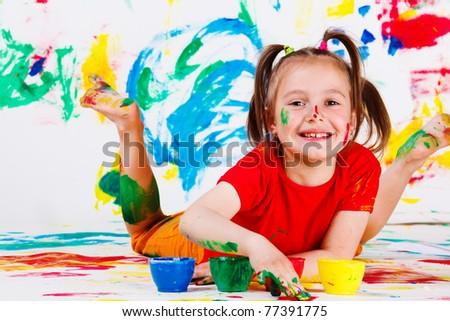 Little happy artist lying
