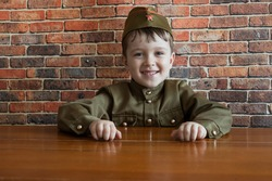 Little happy boy in military uniform at the May 9 celebration in Russia, Victory Day.