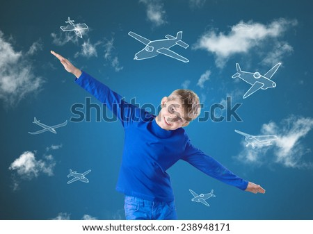 Little happy boy trying to fly like an airplane