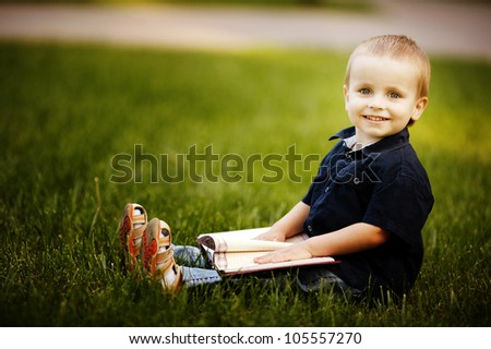 little happy boy with book