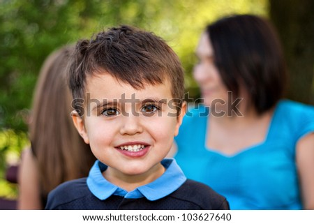 Little happy boy with brown eyes, closeup portrait