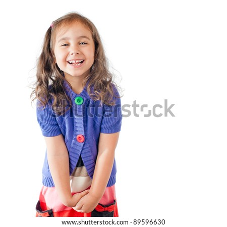little happy girl laughing and looking into the camera. Studio shot, isolated on white background.